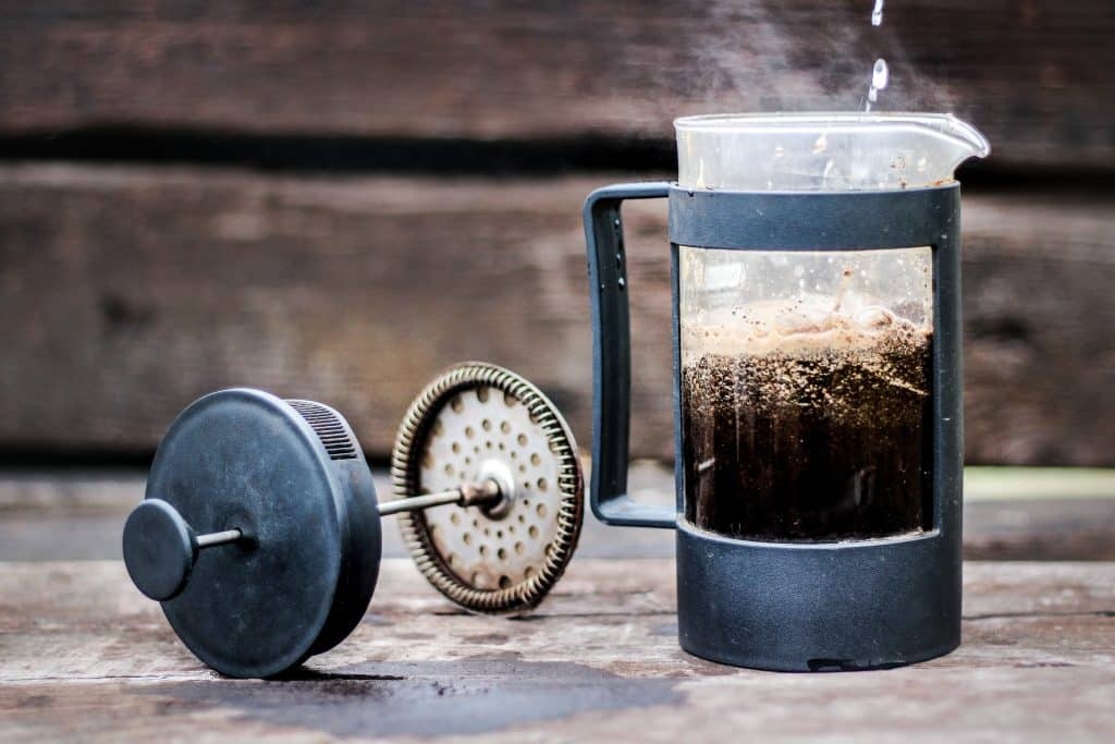 french press blooming for the perfect cup of coffee - Steps to making the best french press coffee