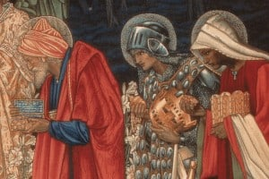 The wise men giving gifts of gold, frankincense, and myrrh
