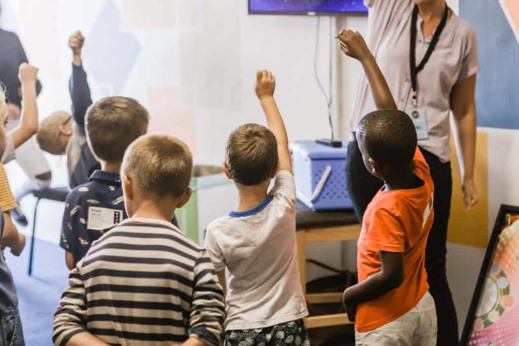 Children playing team building classroom activities